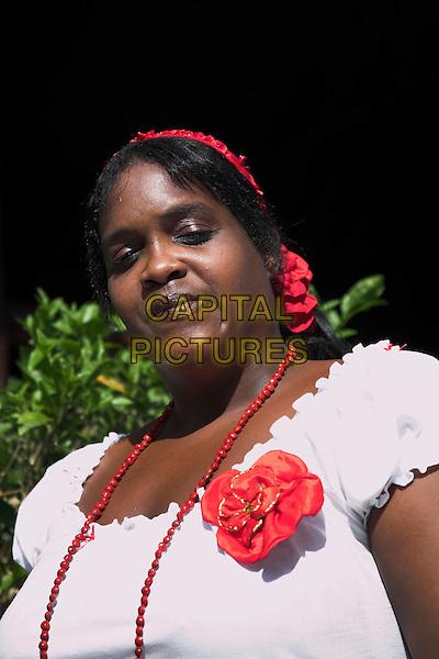 Cuban lady posing, near Holguin, Cuba
