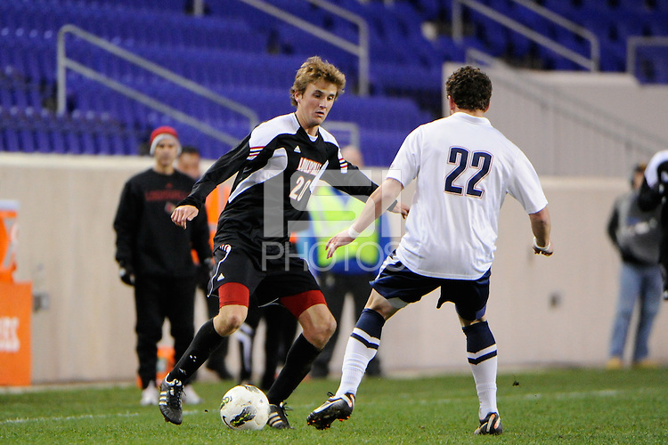 Daniel Keller (20) of the Louisville Cardinals is defended by Max Wasserman (22) of the Connecticut Huskies. Connecticut defeated Louisville 1-0 during the first semifinal match of the Big East Men's Soccer Championships at Red Bull Arena in Harrison, NJ, on November 11, 2011.