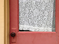 What appears to be newer lace graces an old door at Bille Creek Village, a historical village in Rockville, Indiana