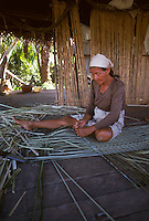 Woman weaving mat, Peru