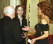 Sophia Loren introduces her husband, Carlo Ponti, to Chelsea Clinton at the Millennium celebration at the White House in Washington, D.C. on December 31, 1999..Credit: Ron Sachs / CNP