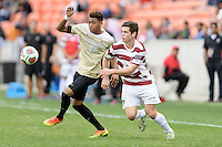 Houston, TX - Friday December 11, 2016: Logan Gdula (17) of the Wake Forest Demon Deacons and Foster Langsdorf (2) of the Stanford Cardinal chase after a loose ball  at the NCAA Men's Soccer Finals at BBVA Compass Stadium in Houston Texas.