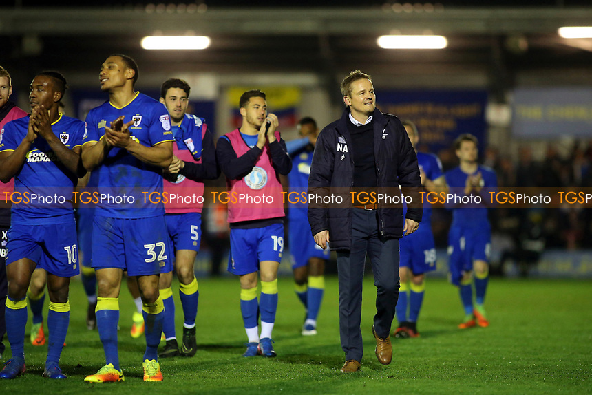 AFC Wimbledon Manager, Neal Ardley, looks delighted as the team walk round the pitch applauding the fans to celebrate their historic victory during AFC Wimbledon vs MK Dons, Sky Bet EFL League 1 Football at the Cherry Red Records Stadium on 14th March 2017