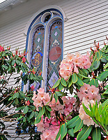Flowers in front of church window in Astoria, Oregon.