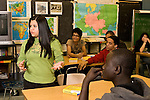 Education High School public social studies history class group of students listening during class female student standing to talk to class horizontal