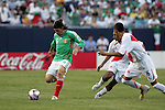 June 08 2008:  Gerardo Torrado (Cruz Azul) (6) of Mexico sets to move the ball past Luis Daniel Hernandez (Sporting Cristal) (16) and Rainer Torres (Universitario) (8) of Peru.  During the third and final match of Mexico's 2008 USA Tour in preparation for qualification for FIFA's 2010 World Cup, the national soccer team of Mexico defeated Peru 4-0 at Soldier Field, in Chicago, IL.