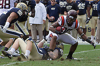 Pitt defensive end Bryan Murphy (93) tackles Virginia Tech running back Michael Holmes (20). The Pitt Panthers defeated the Virginia Tech Hokies 35-17 at Heinz field in Pittsburgh, PA on September 15, 2012.
