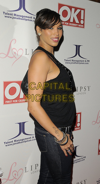 JAVINE HYLTON.The OK! magazine Christmas party, The Living Room, Heddon St., London, England..December 8th, 2008.half length black cowel neck top red nail varnish polish clef music musical note tattoo .CAP/CAN.©Can Nguyen/Capital Pictures.