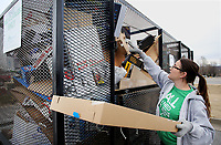 NWA Democrat-Gazette/DAVID GOTTSCHALK Tracie Ashley, of Prairie Grove, drops off Tuesday, January 2, 2018, cardboard in a recycling trailer in front of the Farmington City Hall. The trailer, from Boston Mountain Solid Waste District, is one in the area to encourage cardboard recycling and help with the curbside collection following the holidays.