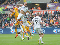 Preston North End's Andrew Hughes vies for possession with Swansea City's Mike van der Hoorn<br /> <br /> Photographer Kevin Barnes/CameraSport<br /> <br /> The EFL Sky Bet Championship - Swansea City v Preston North End - Saturday August 11th 2018 - Liberty Stadium - Swansea<br /> <br /> World Copyright &copy; 2018 CameraSport. All rights reserved. 43 Linden Ave. Countesthorpe. Leicester. England. LE8 5PG - Tel: +44 (0) 116 277 4147 - admin@camerasport.com - www.camerasport.com