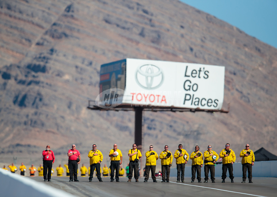 Oct 28, 2018; Las Vegas, NV, USA; NHRA safety safari rescue crew members stand during the national anthem prior to the Toyota Nationals at The Strip at Las Vegas Motor Speedway. Mandatory Credit: Mark J. Rebilas-USA TODAY Sports