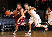 Nov 6, 2010; Charlottesville, VA, USA; Roanoke College g Matt Crizer (25) steals the ball from Virginia Cavaliers g Billy Baron (15) Saturday afternoon in exhibition action at John Paul Jones Arena. The Virginia men's basketball team recorded an 82-50 victory over Roanoke College.