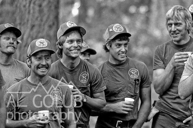 Markleeville, California July 31, 1987.Acorn Fire consumed 26 homes and was heading up a ridge before the Stanislaus Hotshots arrived.  I was embedded with this hotshot crew to create a photo feature and learn about fire fighting.  Greg Overacker was the supervisor of this U.S. Forest Service type one crew.  Greg was a charismatic leader with two nicknames Racks and Sup. 20.  Published in the Modesto Bee..Photo by Al Golub/Golub Photography