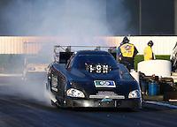 Feb 6, 2015; Pomona, CA, USA; NHRA funny car driver Jeff Arend during qualifying for the Winternationals at Auto Club Raceway at Pomona. Mandatory Credit: Mark J. Rebilas-