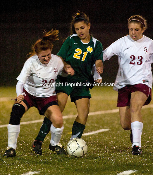 WATERBURY, CT - 20 OCTOBER 2008 -102008JT17--<br /> Sacred Heart's Taylor DeVico, Holy Cross' Teriana Liovvi, and Sacred Heart's Jennifer Massicotte scramble for the ball during Monday's game at Municipal Stadium.<br /> Josalee Thrift / Republican-American