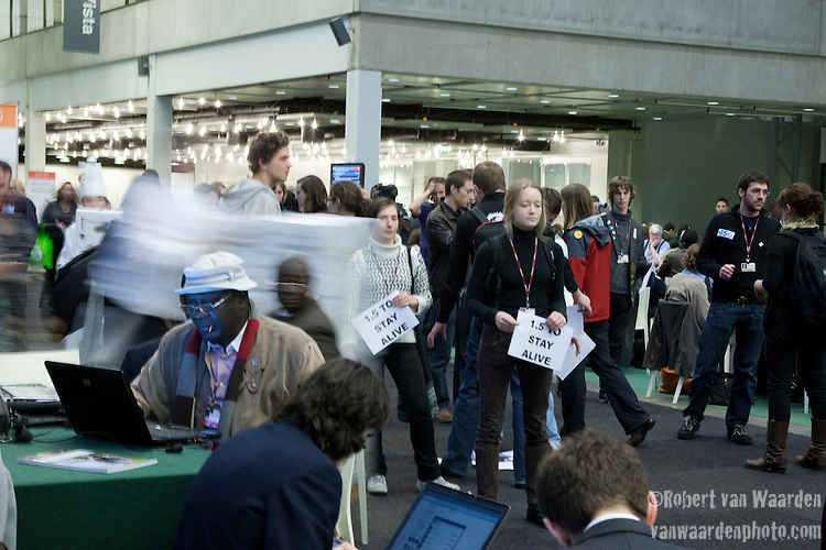 Members of the international youth movement freeze at for at 3:50 in the main hall of COP 15. The action was for 3 minutes, 50 seconds to signify the 350 message and to push delegates to not freeze the talks. (Images free for Editorial Web usage for Fresh Air Participants during COP 15. Credit: Robert vanWaarden)