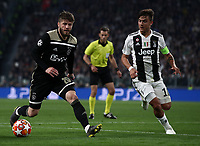 Football Soccer: UEFA Champions UEFA Champions League quarter final second leg Juventus - Ajax, Allianz Stadium, Turin, Italy, March 12, 2019. <br /> Ajax's Lasse Schone (l) in action with Juventus' captain Paulo Dybala (r) during the Uefa Champions League football match between Juventus and Ajax  at the Allianz Stadium, on March 12, 2019.<br /> UPDATE IMAGES PRESS/Isabella Bonotto