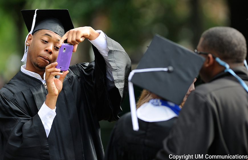 University of Mississippi Psychology major Willie Voss, from Charlotte, NC, makes a funny face as he takes a photo of fellow graduate Etoshia Butler (left), a Biology-Psychology major from Oakland, MS and her friend Bradley Davis, of Oxford, MS on Saturday, May 12, 2012 prior to the Ole Miss commencement ceremony. Photo by Robert Jordan/University Communications