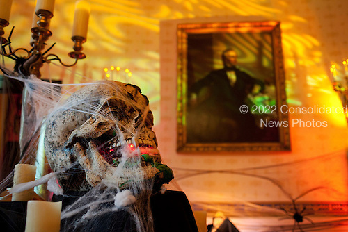 Washington, DC - October 31, 2009 -- A skeleton and candles decorate the Blue Room of the White House in preparation for a Halloween reception for military families and children of White House staff, October 31, 2009. .Mandatory Credit: Pete Souza - White House via CNP