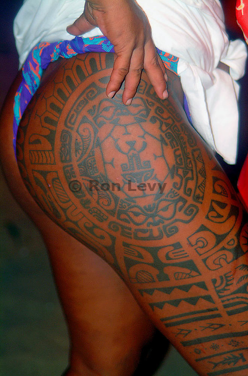 Ceremonial tatoos on leg and butt of dancer, Moorea, Tahiti