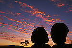 Australia, Northern Territory; Devil's Marbles silhouetted at sunset
