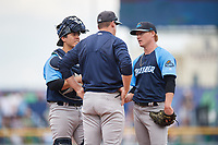 Trenton Thunder pitching coach Tim Norton (45) talks with starting pitcher Nick Nelson (62) and catcher Chris Rabago (26) in a mound visit during a game against the Hartford Yard Goats on August 26, 2018 at Dunkin' Donuts Park in Hartford, Connecticut.  Trenton defeated Hartford 8-3.  (Mike Janes/Four Seam Images)