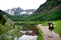 A man photographs the Maroon Bells from Maroon Lake Scenic Trail in Aspen, Colorado, July 12, 2011...Photo by Matt Nager