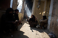 A community of heroin addicts converses  on the second floor of a depot in front of a Mosque  in the city of Rawalpindi, Pakistan on Thursday November 27 2008.///...While Bangladesh, India, Nepal and Maldives all suffer from drug consumption, Pakistan is the worst victim of the drug trade in South Asia. Today, the country has the largest heroin consumer market in the south-west Asia region..The drug addicts resort to crime for generating income for the purchase of narcotics. The situation is becoming serious due to the number of heroin addicts in the country. An alarming rate of increase of 100,000 addicts per year is highly dangerous to society. The drug addicts are affecting nearly 20 million dependents and family members with psychological, social, and economic repercussions.