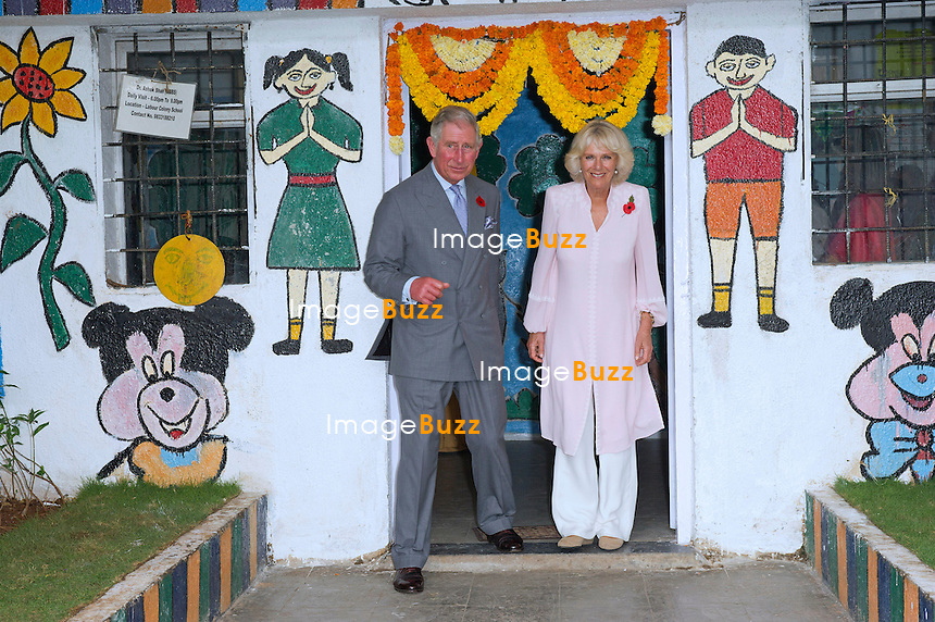 PRINCE CHARLES AND CAMILLA<br /> visit the Mumbai Mobile Creche, New Delhi, India_08/11/2013.<br /> The couple are on a 9-day tour of India