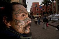 Portrait of tattoos on the profile face of a dark-skinned man in the streets of Guanajuato capital in Mexico, during the Cervantino festival. eye, mustache, beard, look, look, looking. (Photo: LuisGutierrez)<br /> Retrato de tatuajes en el rostro de perfil de un hombre de piel morena en las calles de Guanajuato capital en Mexico, durante el festival Cervantino. ojo, bigote, barba, mirada, mirar, mirando