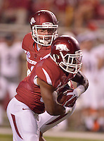 STAFF PHOTO BEN GOFF  @NWABenGoff -- 09/20/14 <br /> Arkansas quarterback Austin Allen hands off the ball to running back Korliss Marshall during the fourth quarter of the game against Northern Illinois in Reynolds Razorback Stadium in Fayetteville on Saturday September 20, 2014. Marshall ran for a touchdown on the play.