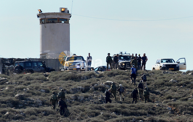 Israeli security forces accompany four Israeli settlers after they was detain for briefly by Palestinian farmers in the West Bank village of Qasra near Nablus, on January 20, 2017. According to reports, the Palestinian villagers briefly detained a group of israeli settlers, accusing them of having thrown rocks at farmers tending to their fields near the village. After a short period of time the Israeli troops arrived and removed the detained settlers and fire tear gas to stop Palestinians. Photo by Nedal Eshtayah