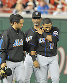 Washington, D.C. - September 16, 2008 -- New York Mets left fielder Fernando Tatis (17) holds his shoulder as he is escorted off the field by manager Jerry Manuel and a trainer against the Washington Nationals at Nationals Park in Washington, D.C. on Tuesday, September 16, 2007..Credit: Ron Sachs / CNP.(RESTRICTION: NO New York or New Jersey Newspapers or newspapers within a 75 mile radius of New York City)
