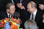 United Nations Secretary-General Ban Ki-moon (L) and Russian President Vladimir toast during a luncheon hosted by Ki-moon during the 70th annual UN General Assembly at the UN headquarters September 28, 2015 in New York City. Obama held a bilateral meeting with Indian Prime Minister Narendra Modi and will have a face-to-face meeting with Russian President Vladimir Putin later in the day. <br /> Credit: Chip Somodevilla / Pool via CNP