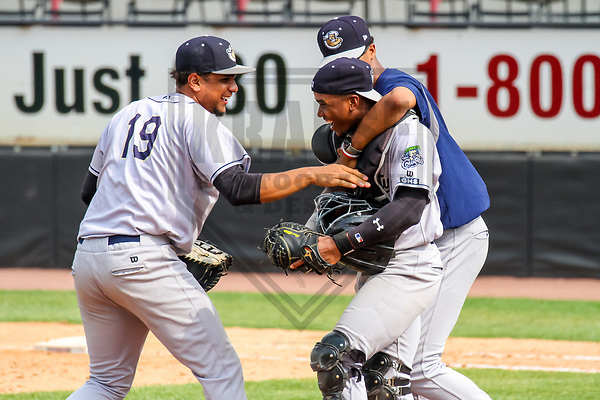 Kane County Cougars first baseman Ramon Hernandez (19), catcher Fernery Ozuna (9) and pitcher Jon Duplantier (40) during a Midwest League game against the Wisconsin Timber Rattlers on June 11, 2017 at Fox Cities Stadium in Appleton, Wisconsin.  Kane County defeated Wisconsin 6-4. (Brad Krause/Krause Sports Photography)
