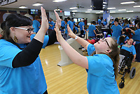 NWA Democrat-Gazette/DAVID GOTTSCHALK Katie Strickland (left) celebrates Wednesday, November 6, 2019, with Emma Crisler, a seventh grade student at Lincoln Junior High School at the Rogers Bowling Center in Rogers. Crisler was competing in the two day Special Olympics of Arkansas Area Bowling Competition. Schools from eight districts participated in the competition.