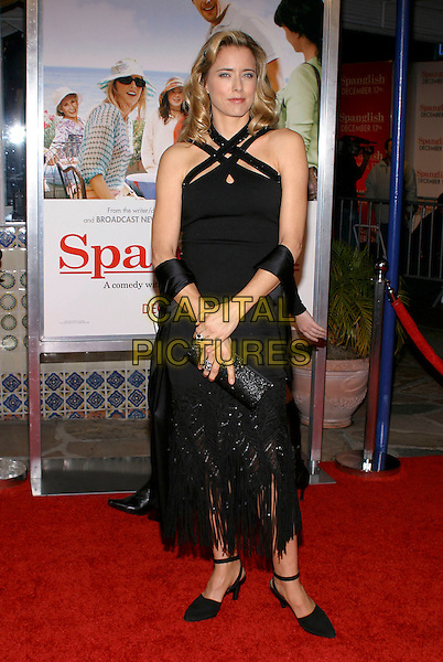 "TEA LEONI.Attends the Los Angeles premiere of ""Spanglish"" held at the Mann's Village Theatre, Westwood, California, USA, December 9th 2005..full length black dress coss over neck halterneck wrap shawl.Ref: ADM.www.capitalpictures.com.sales@capitalpictures.com.©JWong/AdMedia/Capital Pictures ."
