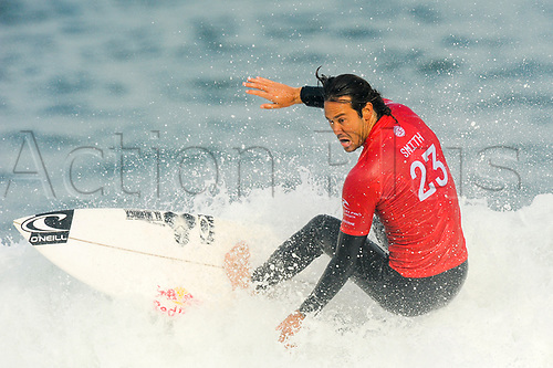 April 19th Bells Beach, Melbourne, Victoria, Australia; Rip Curl Pro Bells Beach Surfing; Jordy Smith (ZAF) looks down as he rides a wave during his quarter final heat against Adriano De Souza (BRA); Jordy Smith (ZAF) went on to win the heat
