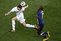 Marko Suler (L) of Slovenia and Jozy Altidore (R) of USA