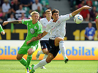 FUSSBALL   1. BUNDESLIGA   SAISON 2011/2012    2. SPIELTAG VfL Wolfsburg - FC Bayern Muenchen      13.08.2011 Simon KJAER (li, Wolfsburg) gegen Mario GOMEZ (re, Bayern)