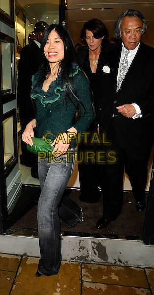 VANESSA MAE & DAVID TANG.Flagship store launch party, Michael Kors boutique, London, England. .April 27th, 2009 .full length jeans denim green ruffled ruffles collar jacket clutch bag black suit .CAP/CAN.©Can Nguyen/Capital Pictures.