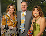 From left: Wendy and Jeff Hines with Andrea White at the Memorial Park Conservancy Gala at The Bayou Club Thursday Oct. 15,2009. (Dave Rossman/For the Chronicle)