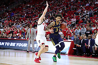RALEIGH, NC - JANUARY 9: Prentiss Hubb #3 of the University of Notre Dame drives past Braxton Beverly #10 of North Carolina State University during a game between Notre Dame and NC State at PNC Arena on January 9, 2020 in Raleigh, North Carolina.