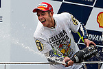 KUALA LUMPUR, MALAYSIA - OCTOBER 25: Fiat Yamaha Team rider Valentino Rossi of Italy celebrates after winning his ninth MotoGP World Championship with his third place in the Malaysian MotoGP, which is round 16 of the MotoGP World Championship at the Sepang Circuit on October 25, 2009 in Kuala Lumpur, Malaysia. Photo by Victor Fraile / The Power of Sport Images