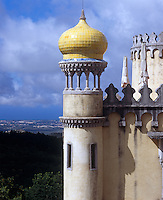 A tiled onion-domed turret with a view of the surrounding landscape