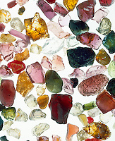 ASSORTMENT OF GEMSTONES<br /> Uncut<br /> aquamarine (light blue),  ruby &amp; garnet (red), sapphire &amp; tanzanite (blue), emerald (green), tourmaline(pink), citrine (brown) ,amethyst (purple)