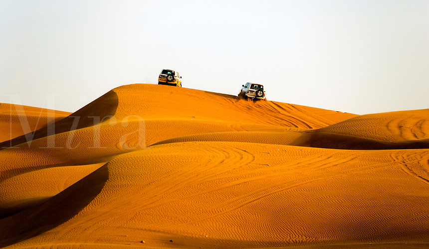 Four wheel drive vehicles  drive in the desert. Dubai. United Arab Emirates.