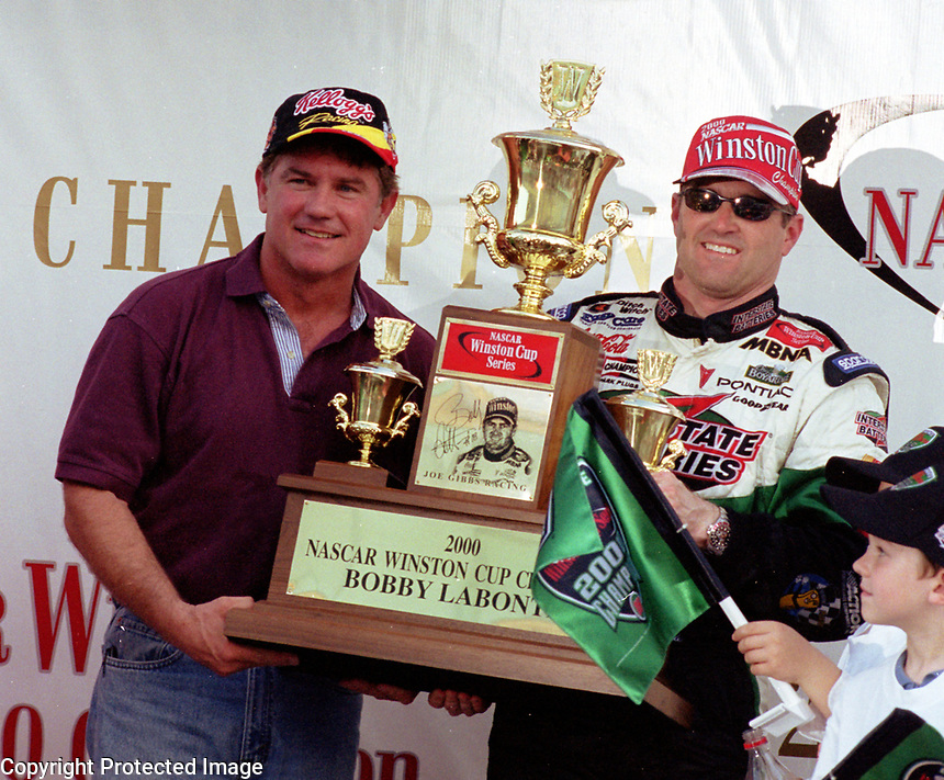 Brothers Terry Labonte (left) and Bobby Labonte celebrate Bobby's 2000 NASCAR Winston Cup Championship after the Pennzoil 400 in Homestead, Florida on 11/12/00.  Terry, who is a two-time champion and Bobby are the only pair of brothers ever to win the award. (Photo by Brian Cleary)