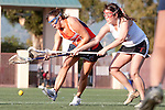 Santa Barbara, CA 02/13/10 - A Pepperdine player and Roslyn Russell (Chico State #7)in action during the Chico State-Pepperdine game at the 2010 Santa Barbara Shoutout, Chico State defeated Pepperdine 14-9.