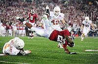 Jan 7, 2010; Pasadena, CA, USA; Alabama Crimson Tide running back Mark Ingram (22) is tackled by Texas Longhorns cornerback Aaron Williams (4) during the third quarter of the 2010 BCS national championship game at the Rose Bowl.  Mandatory Credit: Mark J. Rebilas-